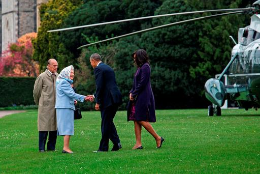 US President Barack Obama and his wife First Lady Michelle Obama are greeted by Queen Elizabeth II and Prince Phillip, Duke of Edinburgh after landing by helicopter at Windsor Castle