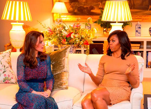 April 2016: Catherine, Duchess of Cambridge speaks with First Lady of the United States Michelle Obama in the Drawing Room of Apartment 1A Kensington Palace as they attend a dinner.