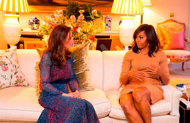 Catherine, Duchess of Cambridge speaks with First Lady of the United States Michelle Obama in the Drawing Room of Apartment 1A Kensington Palace as they attend a dinner on April 22, 2016 in London