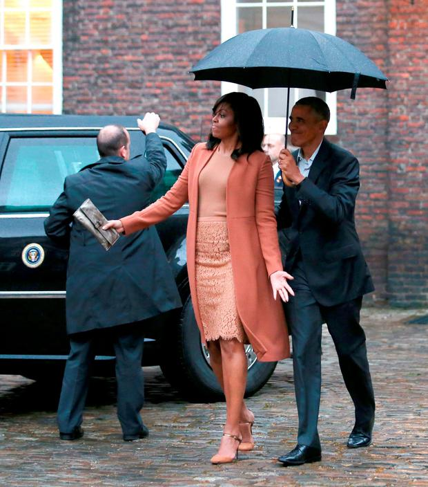 April 2016: US President Barack Obama (R) and US First Lady Michelle Obama (2R) arrive for dinner at Kensington Palace in London.