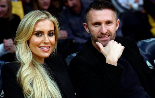 Robbie Keane of the Los Angeles Galaxy soccer team and his wife Claudine Keane attend the basketball game between the Los Angeles Lakers and Charlotte Hornets at Staples Center