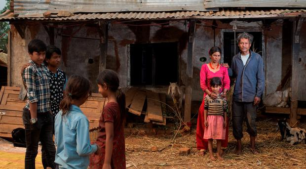 Ram Raja Kumal and his wife Sabitri, parents of Sushila, who vanished last June, at their home in Pipaltar, Nepal. Pictured with Punima (7), who lost her parents in quake. Photo: Mark Condren