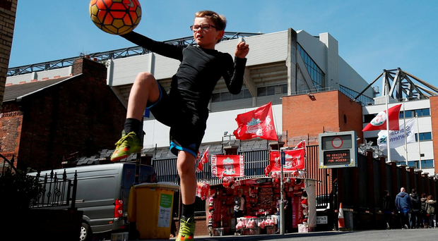 Football Soccer - Liverpool v Newcastle United - Barclays Premier League - Anfield - 23/4/16 Fan plays football outside the stadium before the game Action Images via Reuters / Lee Smith