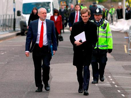Labour party leader Jeremy Corbyn (left) leaves Lindley Hall in Westminster, London, with Seumas Milne, the Labour Party's Executive Director of Strategy and Communications, after a private meeting with US President Barack Obama Credit: Steve Parsons/PA Wire