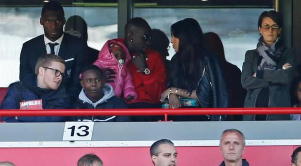 Liverpool's Mamadou Sakho, Christian Benteke and Emre Can in the stands