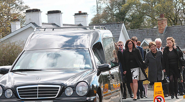 James Downey's wife Moira, daughters Rachel and Vanessa follow his remains through Dromahair. Photo Brian Farrell
