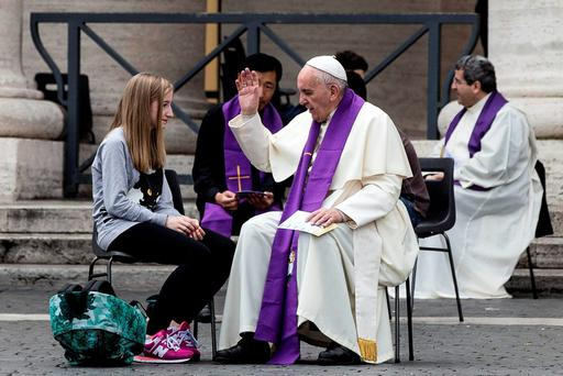 Pope Francis confesses a young faithful during the Youth Jubilee at Saint Peter square in Vatican (Angelo Carconi/ANSA via AP Photo)