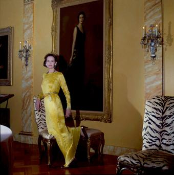 Gloria Vanderbilt in her New York city penthouse for 'Vanity Fair' in 1985. The portrait on the wall is of her mother.