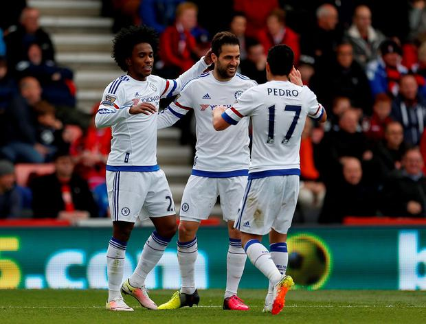 Chelsea's Willian celebrates scoring his side's third goal of the game with team-mates Chelsea's Cesc Fabregas and Chelsea's Pedro during the Barclays Premier League match at the Vitality Stadium, Bournemouth.