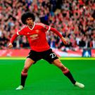 Manchester United's Marouane Fellaini celebrates scoring his side's first goal of the game during the Emirates FA Cup, Semi-Final match at Wembley