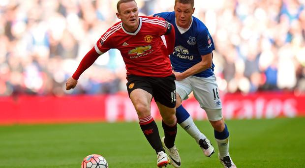 Manchester United's Wayne Rooney in action with Everton's James McCarthy Action Images via Reuters / Tony O'Brien