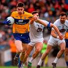 Clare's Jamie Malone in action against Kildare's Ryan Houlihan during last night's Allianz Football League Division 3 final at Croke Park Photo: Ray McManus / SPORTSFILE