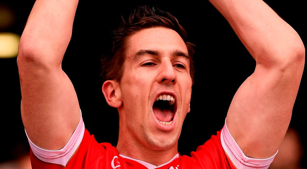 Louth's Pádraig Rath lifts the cup Photo: Ray McManus / SPORTSFILE