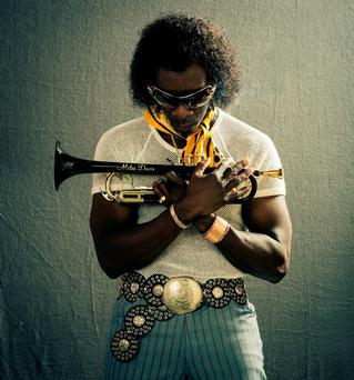 Don Cheadle directs and stars as jazz legend Miles Davis in 'Miles Ahead'