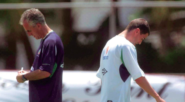 Republic of Ireland captain Roy Keane walks past manager Mick McCarthy during squad training in Adagym, Saipan, ahead of the 2002 World Cup Photo: David Maher / SPORTSFILE