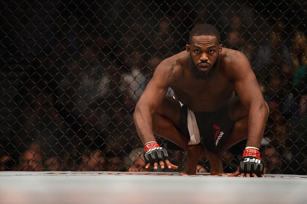 Jon Jones crouches in his corner before facing Ovince Saint Preux in their interim UFC light heavyweight championship bout during the UFC 197 event inside MGM Grand Garden Arena in Las Vegas