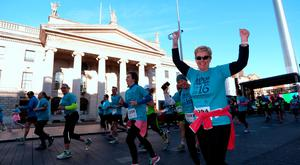 24 Apr 2016: Runners make their way down O'Connell street past the GPO. Dublin Remembers 1916 5K run. O'Connell street. Dublin. Picture: Caroline Quinn