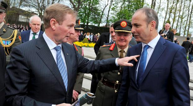Taoiseach Enda Kenny laughs with Micheal Martin of Fianna Fail after the 1916 Arbour Hill Commemoration ceremony. REUTERS/Clodagh Kilcoyne