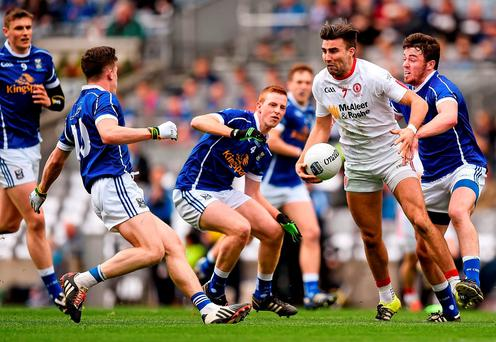 Tiernan McCann, Tyrone, in action against Dara McVeety, left, Conor Moynagh and Jason McLoughlin, Cavan. Allianz Football League Division 2 Final, Tyrone v Cavan. Croke Park, Dublin. Picture credit: Ray McManus / SPORTSFILE