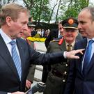 Enda Kenny and Micheal Martin after the 1916 Arbour Hill Commemoration ceremony and requiem mass REUTERS/Clodagh Kilcoyne