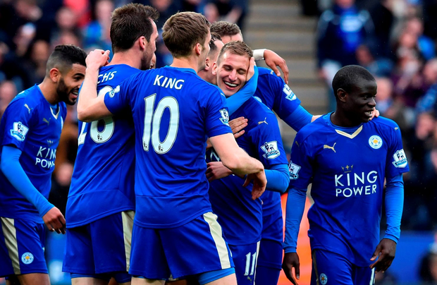 Leicester City's English midfielder Marc Albrighton (C) celebrates scoring their fourth goal during the English Premier League football match between Leicester City and Swansea at King Power Stadium in Leicester, central England on April 24, 2016. / AFP PHOTO / BEN