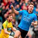Paul Flynn celebrates after scoring Dublin's opening goal while Kerry goalkeeper Brendan Kealy vents his frustration Photo: Sportsfile
