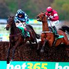 Menorah (left), under Richard Johnson, gets the better of the Willie Mullins-trained Valseur Lido (Bryan Cooper) at Sandown on Saturday. Photo: Charlie Crowhurst/Getty Images