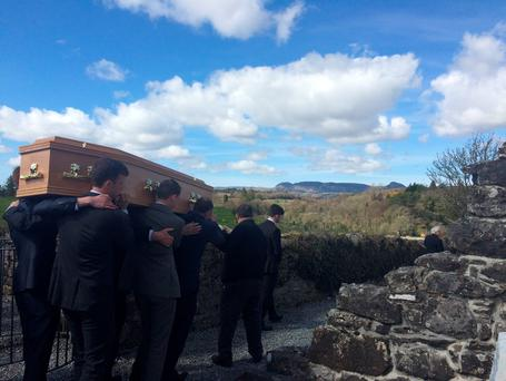 Irish Independent columnist James Downey is carried to his final resting place in the peaceful grounds of Creevelea Abbey in his home village of Dromahair, Co Leitrim, with the Sleeping Man Mountain in the background.