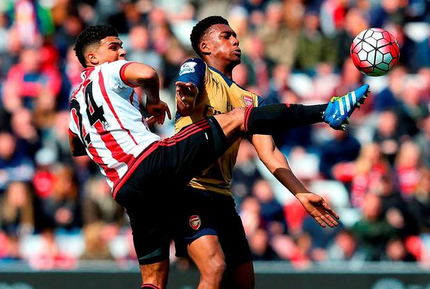Sunderland's DeAndre Yedlin puts his best foot forward as he gets the better of Alex Iwobi during yesterday's Premier League match at the Stadium of Light. Photo: Jan Kruger/Getty Images