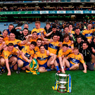 Clare players celebrate after winning the Allianz NFL Division 3 title against Kildare Photo: Ray McManus / Sportsfile