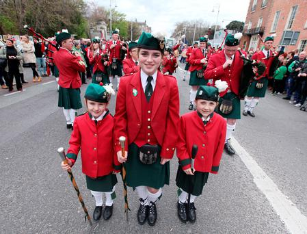 Aoife Eakins, Linden Haughian and Sinead Martin of the St Joseph's Pipe Band from Longstone, Co Down who led the Reclaim 1916 parade from Merrion Square to the GPO yesterday. Inset left: Clara Purcell. Photos: Stephen Collins
