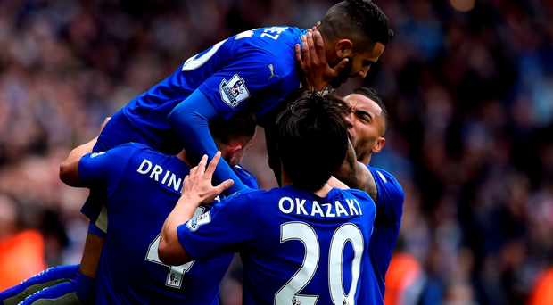 LEICESTER, ENGLAND - APRIL 24: Riyad Mahrez of Leicester City (top) celebrates with team mates as he scores their first goal during the Barclays Premier League match between Leicester City and Swansea City at The King Power Stadium on April 24, 2016 in Leicester, United Kingdom. (Photo by Mike Hewitt/Getty Images)
