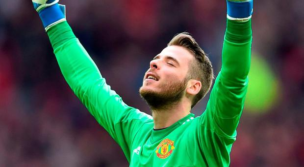 Manchester United goalkeeper David de Gea celebrates after Martial scored their second goal. Photo: Ben Stansall/AFP/Getty Images