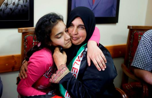 Young Palestinian prisoner Dima al-Wawi hugs her mother following her release yesterday. Photo: Reuters/Abed Omar Qusini