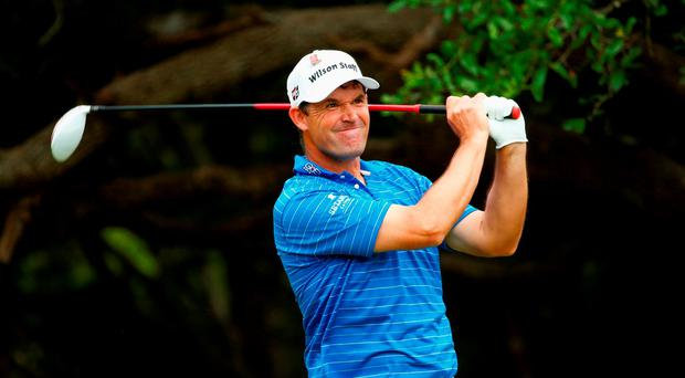 Padraig Harrington of Ireland tees off on the 14th hole Photo: Getty