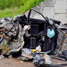 The crushed remains of the family's vehicle