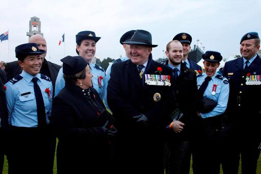 The Governor-General of the Commonwealth of Australia, Sir Peter Cosgrove, center, talks with visitors after the wreath-laying ceremonies at the Australian National Memorial in Villers-Bretonneux, northern France, on Anzac Day, Monday, April 25, 2016