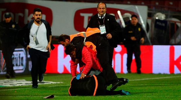 Trabzonspor fan attacks to referee during the Turkish Spor Toto Super Lig football match between Trabzonspor and Fenerbahce