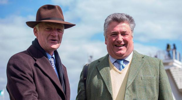 Willie Mullins (left) with Paul Nicholls Photo: Julian Herbert/PA Wire
