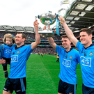 Dublin players Denis Bastick, holding his son Aiden, Cormac Costello, Diarmuid Connolly and Paul Flynn celebrate after beating Kerry in Croke Park Photo: Dean Cullen / SPORTSFILE