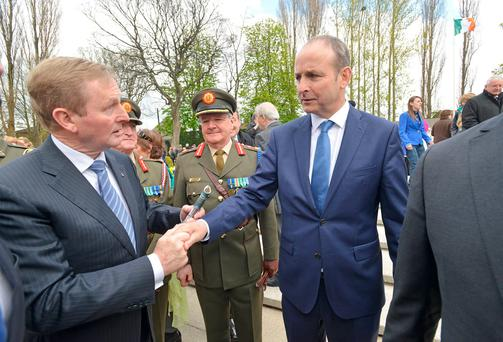 Enda Kenny meets Micheál Martin during the Easter Rising Ceremony at the Arbour Hill Cemetery on Sunday. Photo: Barbara Lindberg