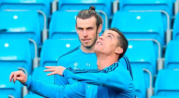 Gareth Bale watches as Cristiano Ronaldo goes through his paces at the Etihad Stadium last night Photo: Martin Rickett/PA Wire