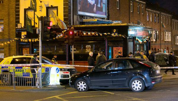 Members of the Gardai attend the scene of a shooting at the Sunset House Pub in Ballybough, Dublin.