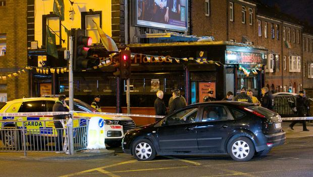 Members of the Gardai beside the scene of a shooting at the Sunset House Pub in Ballybough, Dublin. Photo: Gareth Chaney Collins