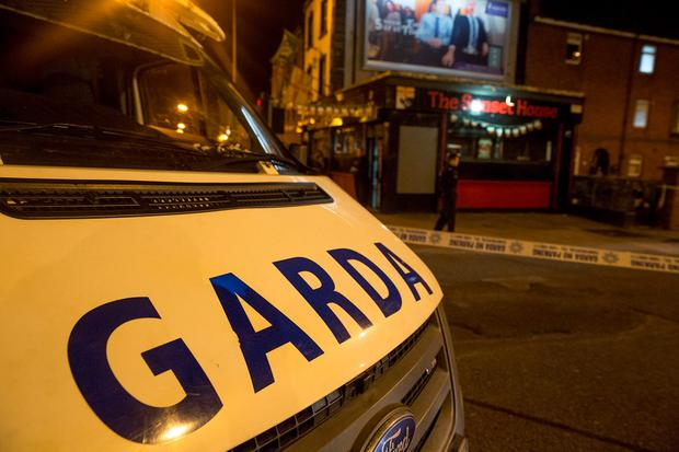 Gardai investigate the shooting of aman at the Sunset House House pub in Summerhill, Dublin.. Pictures:Arthur Carron
