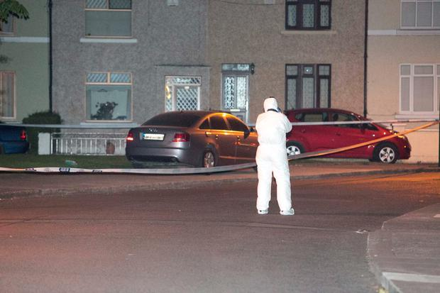 Members of the Gardai on the Walsh Road in Drumcondra, Dublin. Photo: Gareth Chaney Collins