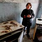 Tatyana Chernyavskaya, 65, poses for a photograph in her flat which was evacuated after an explosion at the Chernobyl nuclear power plant, in the ghost town of Pripyat, Ukraine April 18, 2016. For residents of Chernobyl, a three-day evacuation turned into a thirty-year exile
