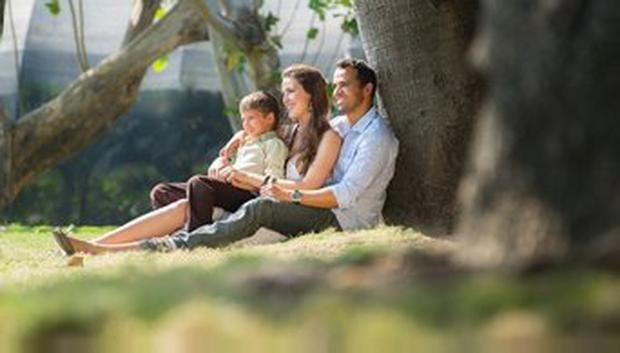 Foster family enjoying a sunny day in the park