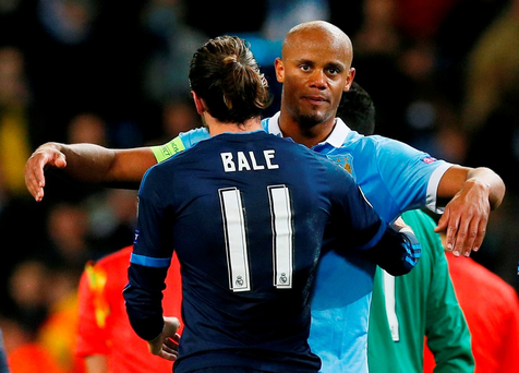 Vincent Kompany embraces Gareth Bale. Action Images via Reuters / Jason Cairnduff Livepic.