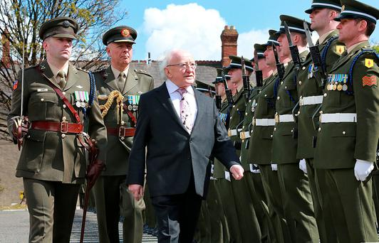 President Michael D Higgins pictured as he inspects the Guard of Honour from the 7th Inf Batt with Capt John Quinn [left] and Col Mick Kiernan [ADC to the President] before the President officially opened the Military Archives during a ceremony at Cathal Brugha Barracks in Rathmines. Picture Credit : Frank McGrath